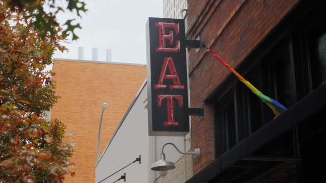 Day View of Neon Eat Sign in City video