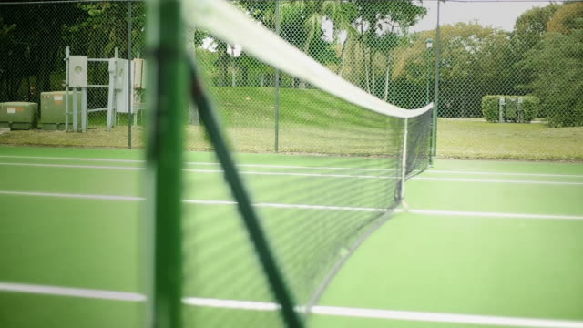 Daylight Shot of Net at Tennis Court from Inside of the Court video