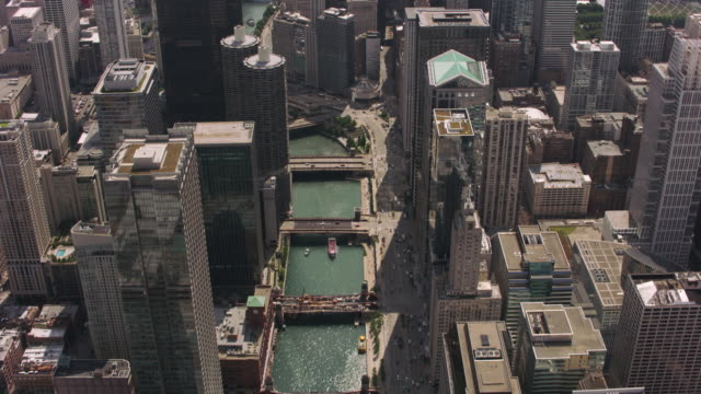 Daytime aerial shot of downtown Chicago and Chicago River. Chicago, Illinois circa-2017, Daytime aerial shot of downtown Chicago and Chicago River.  Shot with Cineflex and RED Epic-W Helium. chicago stock videos & royalty-free footage