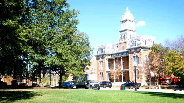 Daytime establishing shot of a Victorian building in small american town video