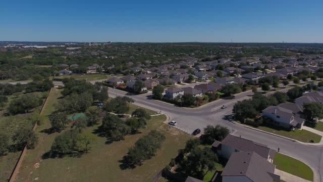 daytime high angle flyover of typical texas residential neighborhood - san antonio texas stock videos & royalty-free footage