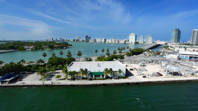 Daytime traveling shot of Miami Beach from the water. video