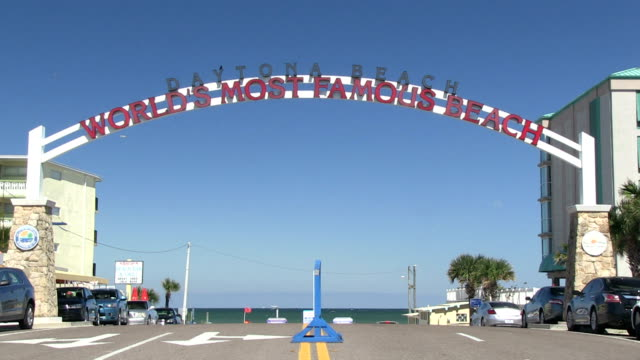 """Daytona Beach The iconic """"World's Most Famous Beach"""" sign at the  main entrance of the beach of Daytona Beach in Florida. florida us state stock videos & royalty-free footage"""