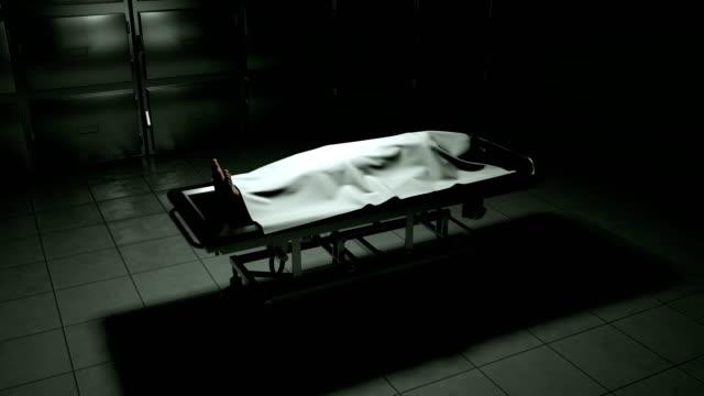 dead body in morgue on steel table. - cadavere video stock e b–roll