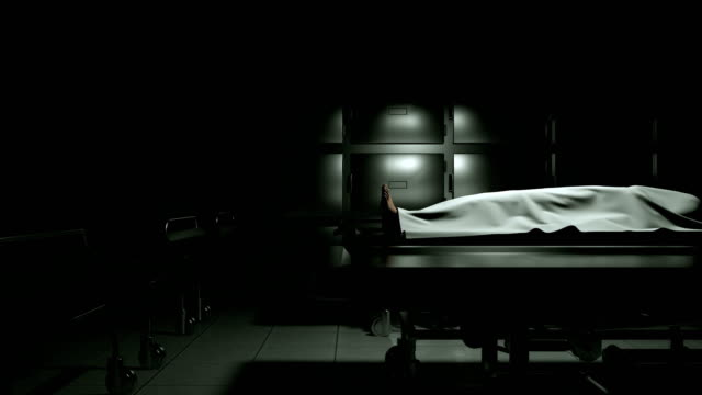 dead body in morgue on steel table. - morte video stock e b–roll