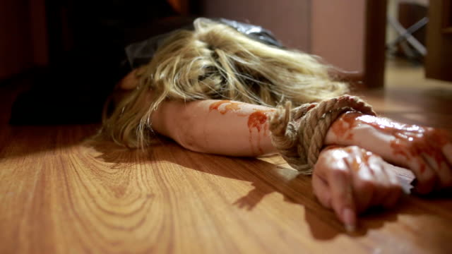 dead girl in plastic bag. killer dragged body of his victim. domestic violence video