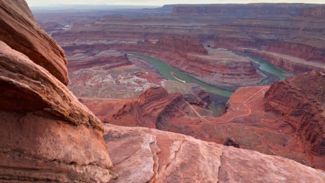 Dead Horse Point State Park, Utah, USA. Сamera moves over a cliff, view of canyon and colorado river. Steadicam shot, 4K