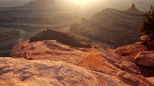 Dead Horse Point State Park, Utah, USA. Red rocks seen below during sunset. UHD, steadicam shot