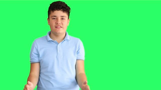 a deaf teenage boy shows the sign language 2 - hearing aid стоковые видео и кадры b-roll