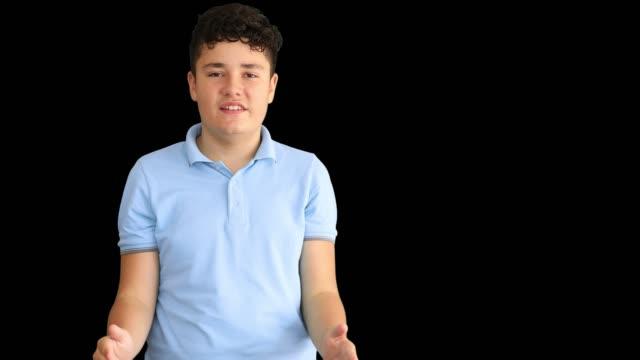 a deaf teenage boy shows the sign language 3 - hearing aid стоковые видео и кадры b-roll