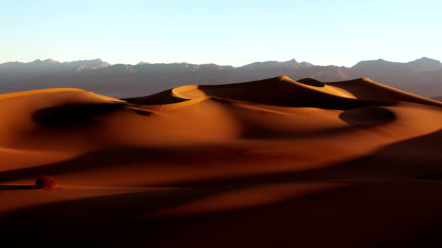 Death Valley Dunes at Sunrise Death Valley, California. Sunrise at the dunes. Time lapse. Desert Dawn. A sandy desert landscape in the mountains. Moving shadows. mojave desert stock videos & royalty-free footage