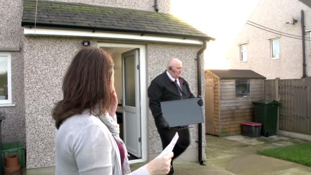 Debt collector / Bailiff / Repo Man taking TV set : Crane video