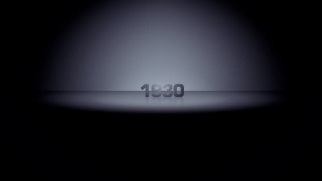 Decade Horizon Zoom 1930 HD. 1930. Date emerges from dark horizon in a burst of light and zooms toward camera, illuminated by moving spotlight. Slows to brief stop in foreground, then continues past camera and returns to darkness. 20th century stock videos & royalty-free footage