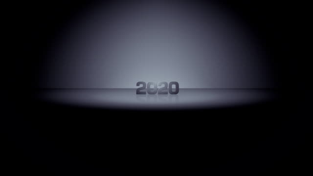 Decade Horizon Zoom 2020 HD. 2020. Date emerges from dark horizon in a burst of light and zooms toward camera, illuminated by moving spotlight. Slows to brief stop in foreground, then continues past camera and returns to darkness. 2020 stock videos & royalty-free footage