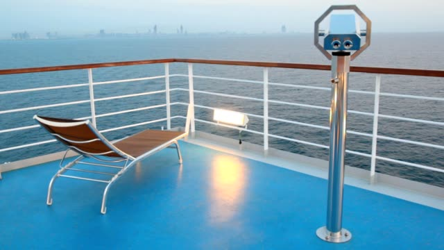 Deck chair and stationary binocular on cruise ship video