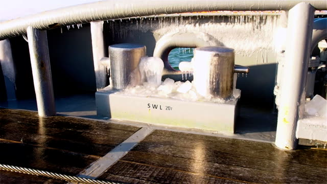 Deck of tug with icy bollard in sunny winter morning video