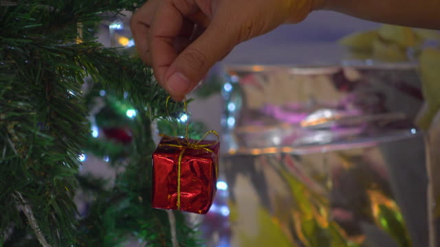 Decorate Gift Box On Christmas Tree
