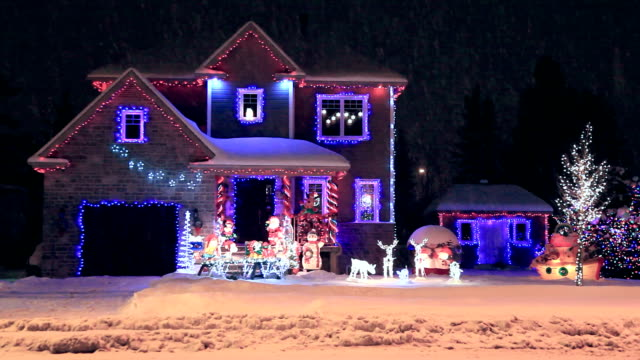 Decorated and illuminated House for Christmas DSRL video of a decorated house for christmas. The video was taken at night, it is snowing and all the decorations are illuminated. There is no people in the video. christmas lights stock videos & royalty-free footage