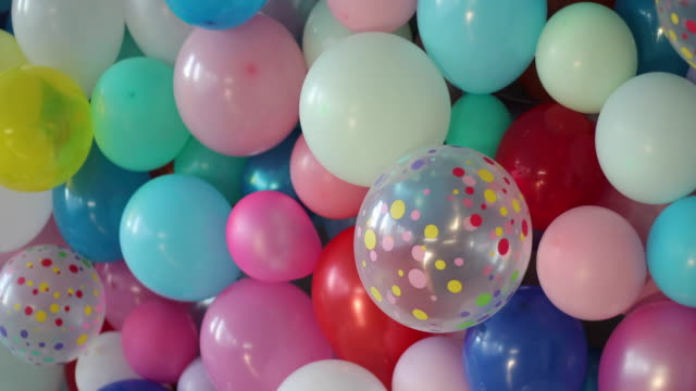 Decorated room with balloons Wall full of colorful balloons, bunch of balloons hanging in decorated room birthday background stock videos & royalty-free footage