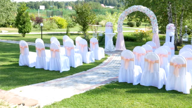 Decorated rows of chairs at the wedding ceremony. video