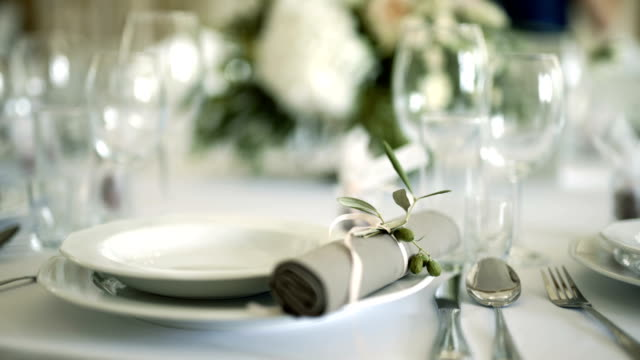 decorated table for a wedding dinner - matrimonio video stock e b–roll