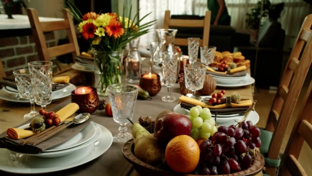 decorated table for thanksgiving dinner with candles, pumpkins, leafs and nuts - thanksgiving background stock videos & royalty-free footage