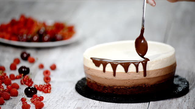 Decorated triple chocolate mousse cake.