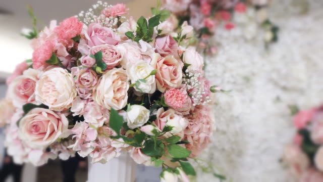 Decorated wedding ceremony with a bouquet of fresh flowers.