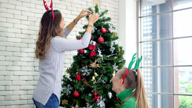 Decorating christmas tree Christmas time is event