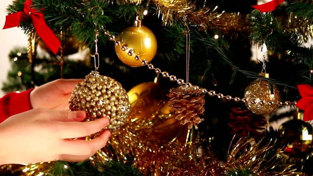 Decorating Christmas tree close-up video