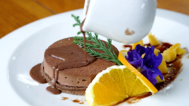 Decorating mousse cake with chocolate sauce. video