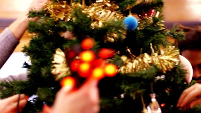 Decorating the Christmas Tree takes Teamwork video