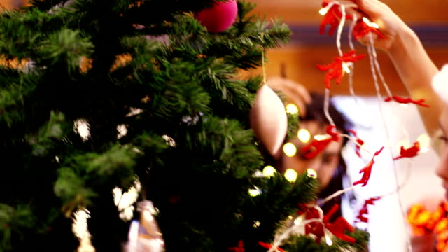 Decorating the Christmas Tree with Friends video