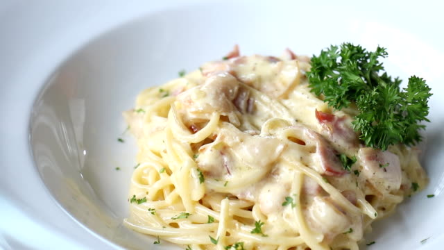 Decorating top of Spaghetti Carbonara with egg video