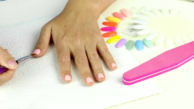 Decoration design by silver glitter on pink color gel female nails video