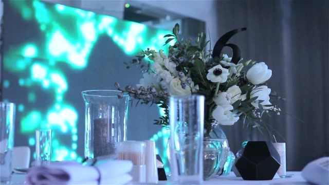 decoration of a banquet hall, flowers, fresh, beautiful, glasses, restaurant, interior, new year, christmas, new year holidays video