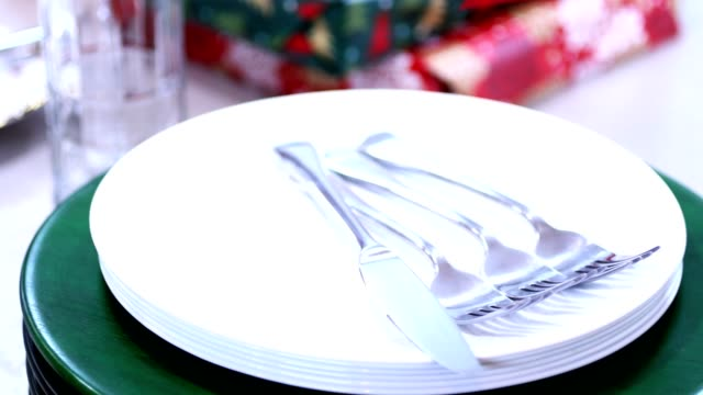 Decorations on table set for family holiday gathering. video