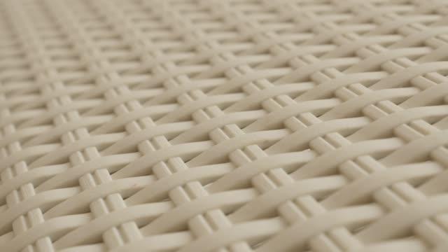 decorative artificial rattan material furniture close-up 4k - poliuretano polimero video stock e b–roll