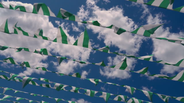 decorative flags flying on a wind against blue sky - memorial day weekend stock videos & royalty-free footage