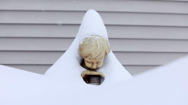 Decorative Garden Gnome Covered under heavy snow