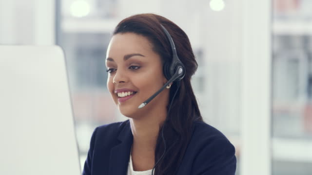 Dedicated to delivering the best service to her clients 4k video of a young call centre agent working in an office call centre videos stock videos & royalty-free footage