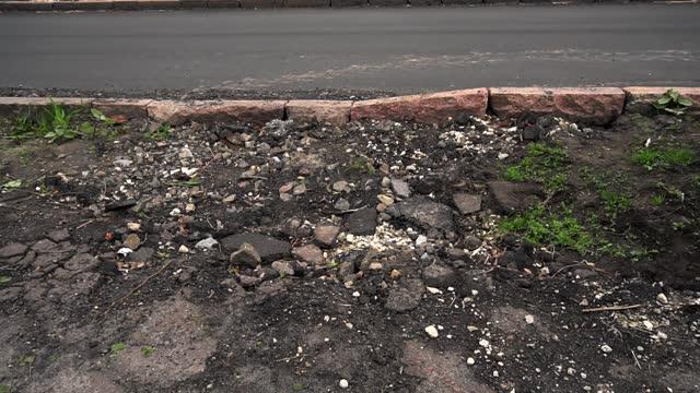 deep cracks in asphalt. View of broken in road.