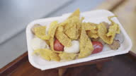 istock Deep fried meatballs and dumplings in foam box. Thai street food snack. 1282769507