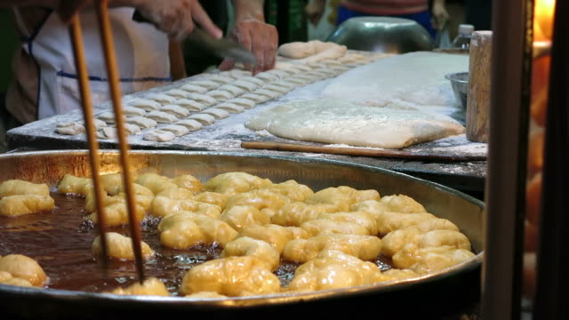 Deep-fried dough sticks in China Town video