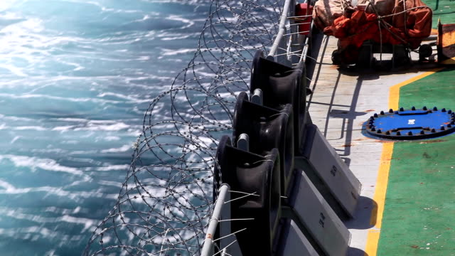 Defence Vessel fixing barbed wire protection for antipiracy defence. HD 1920X1080 30p Canon Mark 2. horn of africa stock videos & royalty-free footage