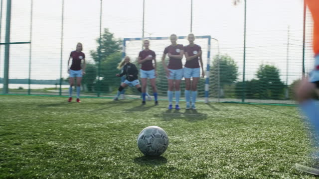 Defensive wall in female soccer match Female soccer player to take a free kick through defensive wall of rival team goal post stock videos & royalty-free footage