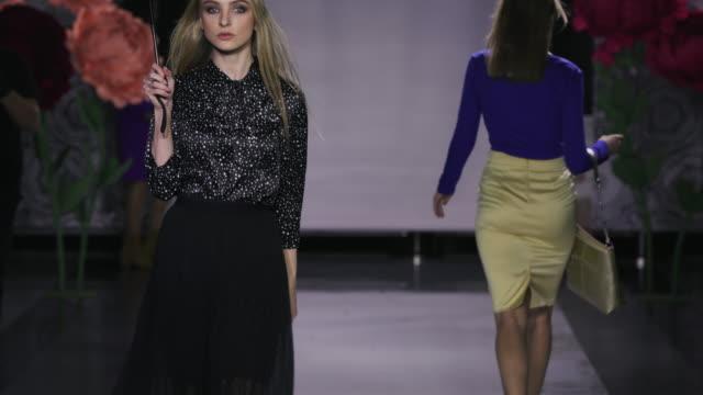 Defile beautiful women hold umbrella catwalk model show vogue. Girl podium 4k. video