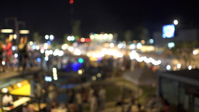 defocus crowd on night market - souk video stock e b–roll