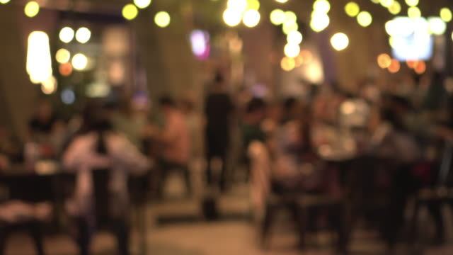 Defocus nightlife in yellow light background People lifestyle bar counter stock videos & royalty-free footage