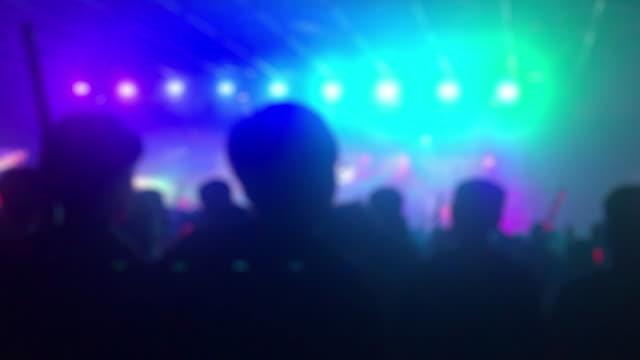 Defocus people enjoy music in bar or concert hall